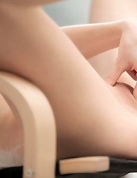 Slender siren Adrianne slips out of her sheer lingerie to give her wet creamy landing strip pussy a deep finger pounding