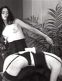 Retro-shot S&M mistress spanks her maid
