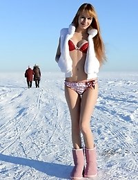 Fascinating Charmer Undressing And Showing Tempting Body Outdoor Right On The Winter Snow.
