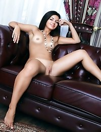The Perfect Combination, Artistic Nude Photo Model And Robust Sofa Upholstered In Warm Leather. Both