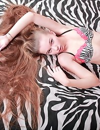 Stunning Teenie Seductively Posing In The Sheets Stripping Off Her Zebra Printed Lingerie.