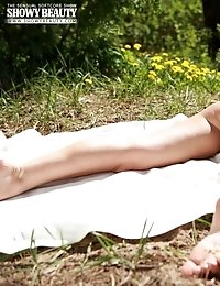 Seductive Beauty Enjoys Her Summer Day By Lounging Naked In The Sun And Posing On Camera.