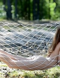 Delightful Shapely Teen Cutie Stripping And Posing In The Nude Outdoors In The Hammock.