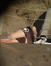 Upskirts on the beach - cute brunette flashed