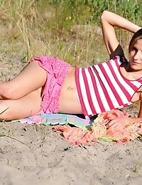 Hot Summer Day Always Hold Some Unpredictable Sexy Fun. Sandy Beach With A Fresh Breeze Is The Best