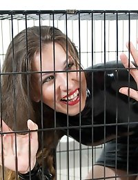 Latex slave gets locked in a small cage