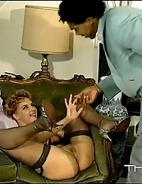 Blonde sucking big black dick in a retro threesome
