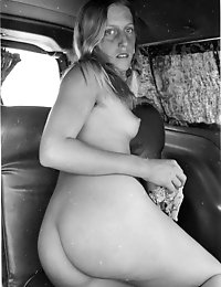Retro babe gets talked into posing in the car