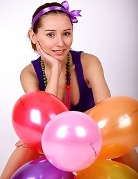 Charming Teenie Plays With A Bunch Of Balloons Then Strips Down Totally Naked And Poses.