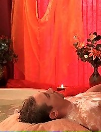 Smoking hot babe massages a lucky guy