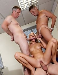 Blonde slut takes it in two holes at the office