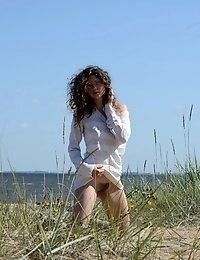The Beach And Sunshine Only Adds To Her Stunning Teen Beauty And The Way She Slowly Strips Naked Fro