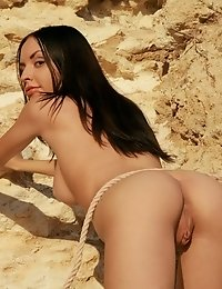 Stunning Brunette Model Shows Off Her Perfect Nude Body And Sweet Pussy In The Rocky Cave.