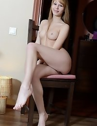 Beautiful Long Haired Slim Cutie With Lovely Breasts Posing Absolutely Naked On The Chair.