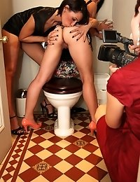 Amazing brunettes eating each other in the toilet