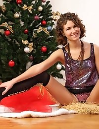 19 Y.o. Curly Sweetheart Poses In Nothing But Knee High Stockings By The Christmas Tree.
