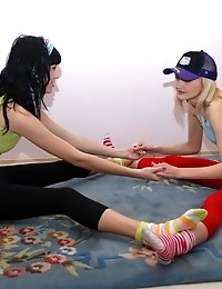 Two Hot Lesbian Chicks Fondle Each Others Sensitive Legs And Other Spots Of Their Bodies