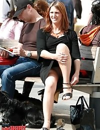 Redhead milf on a bench. Candid sitting upskirt