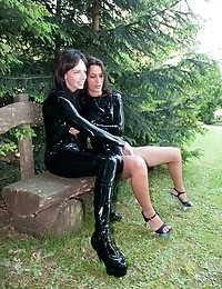 Latex hotties kiss and massage each others pussies