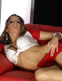 Stunning whore Ana gets seductive on the red sofa