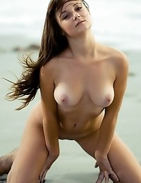 Totally Nude Chick With Big Natural Boobs Shows Off Her Juicy Body On A Sandy Sea Shore.
