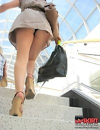The real upskirt - voyeur blonde in public place