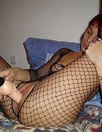Chick in sexy fishnet dildo packing the cunt