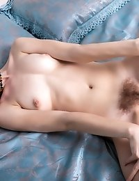 Skinny Blonde Babe Poses Naked In Her Bed And Plays Around With Her Hairy Little Teen Pussy With Som