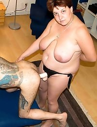 Tattooed skinny guy takes dildo from fat wife