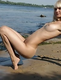 Nothing In The World Can Be Compared With This Nude Attractive Beauty As She Is Posing On The Rocks