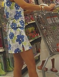 Prudent chick spyed in a shop. Upshorts looking up skirts