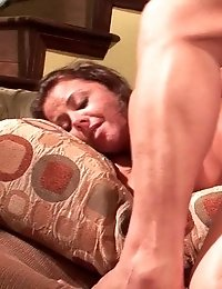 Hot babe gets fucked to orgasm on the sofa