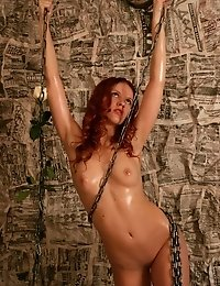 Splendid Nude Angel Is Swinging On Big Chains With A White Rose In An Extraordinary Room Papered By