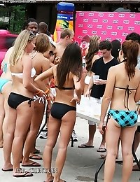 Teens in swimsuits have active fun