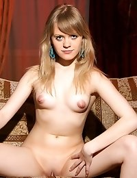 Gorgeous Naked Teen With Perky Tits Spreading Legs And Flaunting Shaved Pussy On The Couch.