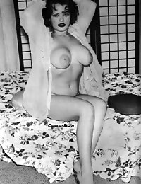 Big titted lady poses in and without stockings