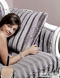 Adorable Dark Haired Model In Sexy Black Shoes Demonstrating Naughty Holes On The Sofa.