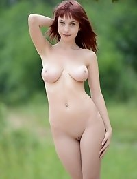 Marvelous Busty Redhead Hippy Girl Stripping Clothes And Posing In The Nude In The Woods.