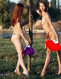 Two Extremely Sexy Lesbians Showing Their Stunning Slim Bodies And Kissing Gently One Another Outdoo