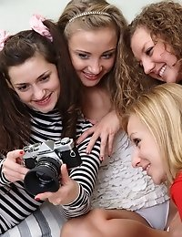 Four Teen Cuties Gathered Together In A Bedroom To Indulge Themselves In A Wet Lesbian Orgy.