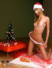 Astounding Nude Angel Is Posing Near Christmas Trees And Fondles The Nude Humps Of Her Amazing Body.