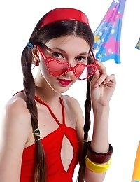 Gorgeous Dark Haired Teen Girl With Red Glasses In The Shape Of Hearts Posing With Tape Recorder.