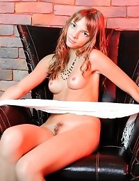 Admirable Teen Hottie With Lovely Nipples And A Hairy Twat Slugging Naked In A Chair.