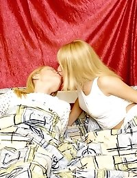 Two Young Blondes Enjoy Playing Dirty In Bed