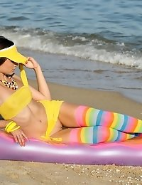 Gorgeous Teen Beauty In Bright Stockings Showing Hot Body On The Air Mattress On The Beach.