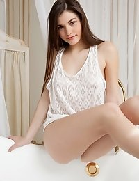 Have A Look At This Amazing Glamour Teen Babe As She Takes Off Her Sexy White Lingerie To Show That